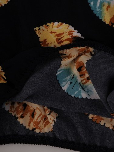 Bluzka wykończona ozdobnymi gumeczkami 14974.