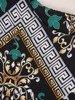 Asymetryczna sukienka z wycięciami na ramionach w modnym wzorze 23547